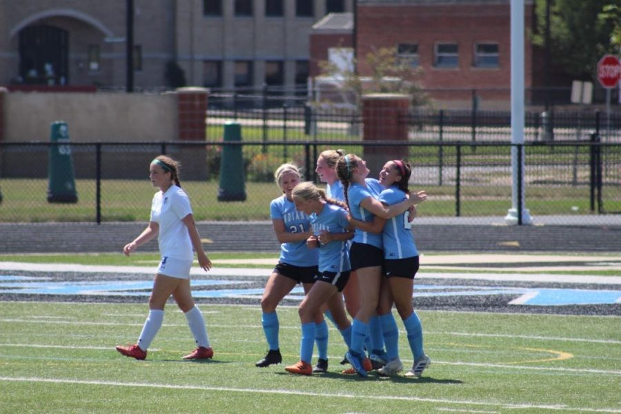 The girls celebrate after a goal by Ella Scott in the 58th minute