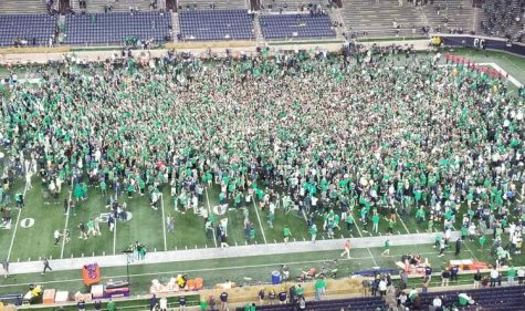 Notre Dame fans rush the field after beating Clemson in 2OT