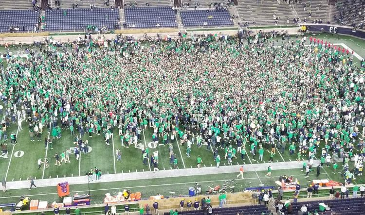 Notre+Dame+fans+rush+the+field+after+beating+Clemson+in+2OT