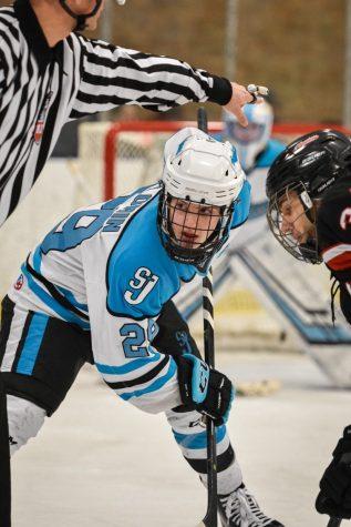 Center, Jack Plomin facing off against LSJ