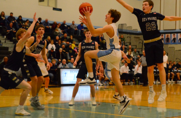 Jack Quinn looks to score in a game against New Prairie, as winter sports have new protocols.