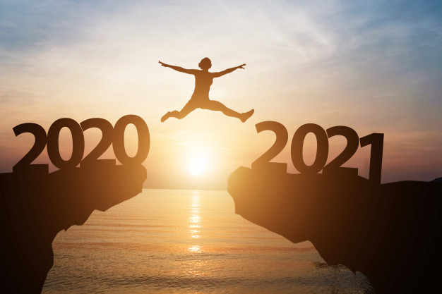 Credit: https://www.freepik.com/premium-photo/man-jumps-from-year-2020-2021-with-sunlight-sea-as-background_8706426.htm