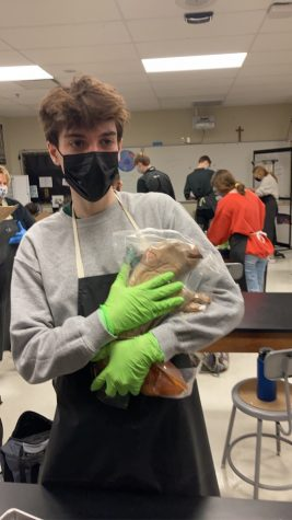 Student Elliot Young holding his pig.