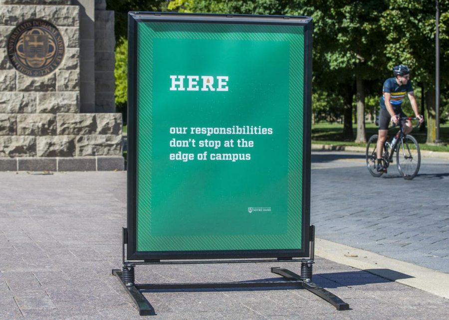 A HERE sign outside of the University of Notre Dames campus.